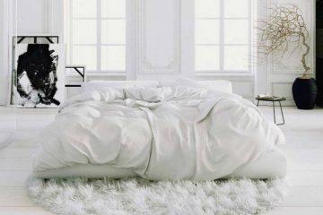 Cama con sábanas